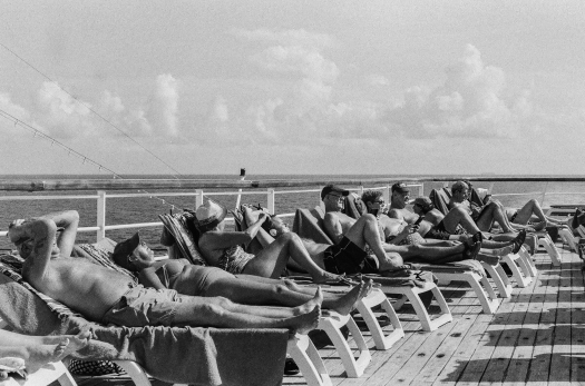 Sun beds in high demand on a day at sea