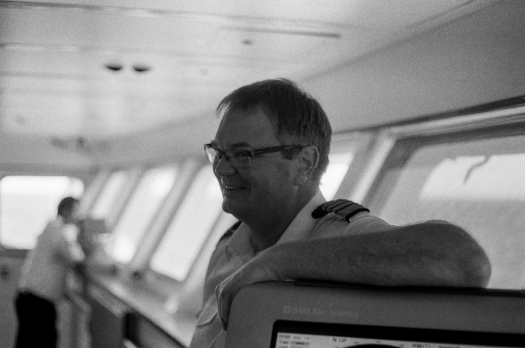 Norwegian Captain, Terje Ulset takes a moment to relax on the Bridge, in his very serious job of being responsible for every last one of the 2100 souls onboard.